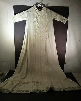 Antique baby christening gown with lace frontispiece  and lace edging