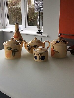 Teapot, Tea And Coffee Canisters, Sugar Bowl And Salad Dressing Bottle