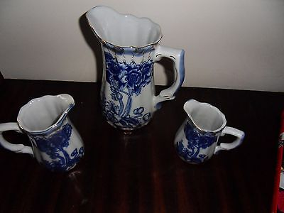 set of 3 matching vintage jugs milk, gravy blue and white with gold rim