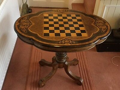 A Fine Exhibition Quality Victorian Walnut Marquetry Games Table