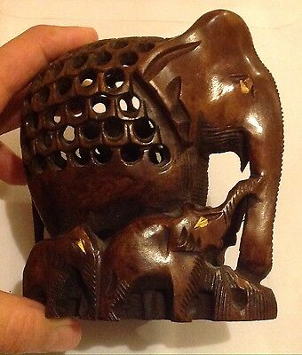 Beautiful Wooden Hand Carved Elephants Containing Tiny Elephant