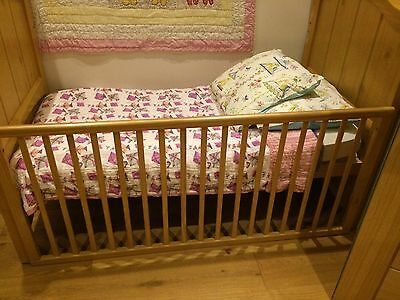 Cotbed in excellent condition, with a nappy changing unit and mattress