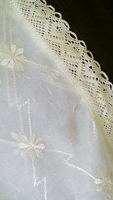 A vintage lace embroidered tablecloth