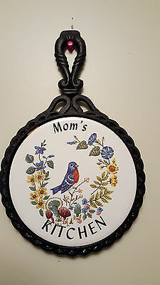 Black Cast Iron Trivet Hanging  Mom's Kitchen on White Tile Blue Bird Flowers