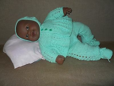 """Brown 20"""" (51 cm) Doll in Knitted New Green outfit."""