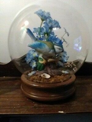 Artificial Terrarium Floral Glass Globe With Wood Base and a bird on a stump