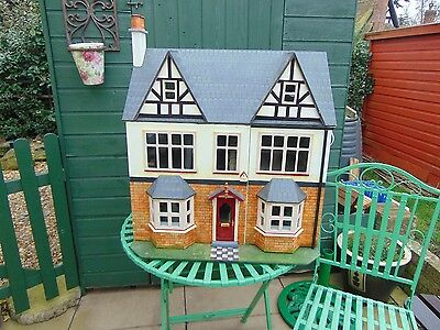 Dolls house with working electric lights.