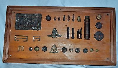 WW1 Memorabilia mounted on a wooden frame trench art shell radio badges buckle 3