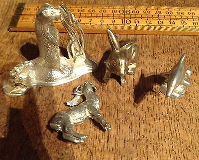 A Small Collection Of Vintage Metal Animal Ornaments