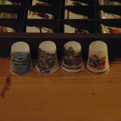 Collection of 4 china thimbles