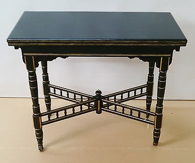 Ebonized Folding Card Table with details picked out in gold.