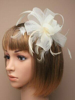 Cream white fascinator comb with looped net ribbon and feather tendrils
