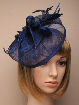 Navy blue fascinator with hessian hat, petals, loops and feather tendrils.