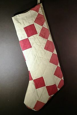 Stocking made from antique red and white quilt