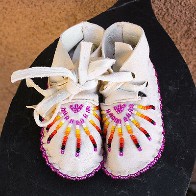 SOFT WHITE LEATHER BEADED STARBURST BABY MOCCASINS by JANET WHITEMAN - CHEYENNE