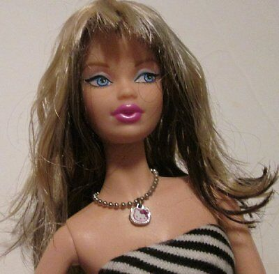 BARBIE Doll HELLO KITTY Steffie face model muse body 1 arm bent dressed