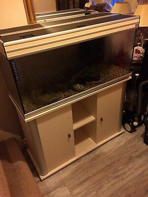 large fish tank with cabinet, white.