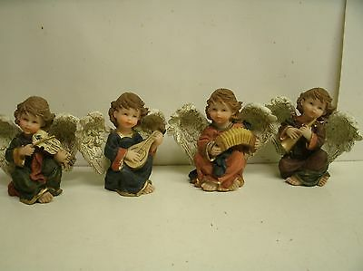 Lot of 4 cherub Angel Figurines w Musical Instruments