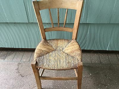 Wooden children's chair with rush caning.