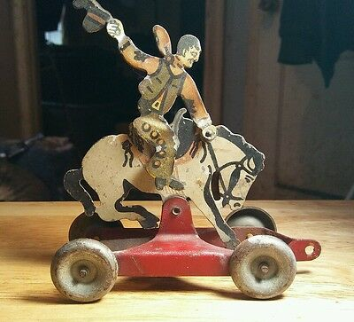 Vintage Antique Tin Pull Toy Bucking Horse And Cowboy in Working Condition!