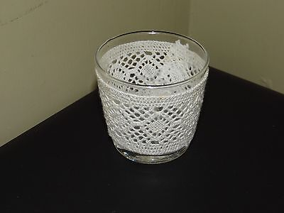 Handmade lacecovered glass candle holder