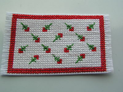 Dolls house rug cross stitch handmade red flowers on white background
