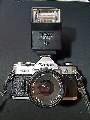 Canon ae-1 With 28mmLens and vivatar 530fd Flash