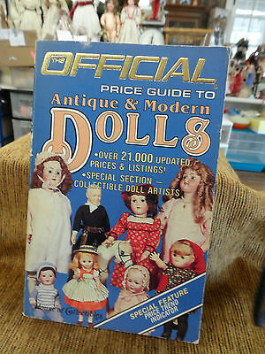 The Official Price Guide to Antique & Modern Dolls.  Cr. 1985  Soft cover