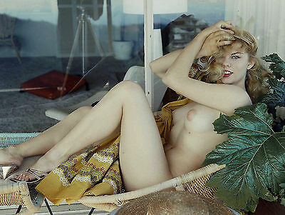 1950s Nude Blonde Pinup Lying in wicker chair on patio   8 x 10 Photograph
