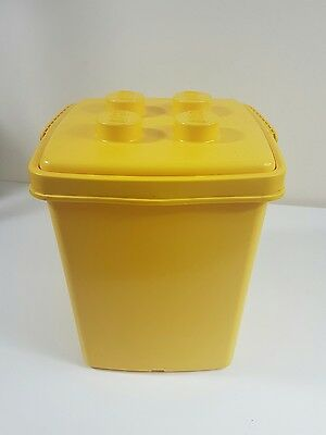 Empty yellow lego duplo storage box with carry handle