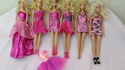 Bundle of Genuine Barbie dolls & outfits, great condition!