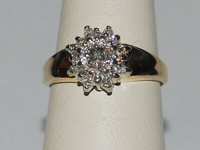 10K Gold ring with cluster of diamonds in a flower pattern