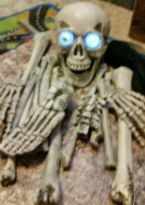 Bag Of Bones With Light Up Eyes with sensor, creepy laugh 18pc Halloween Scary!