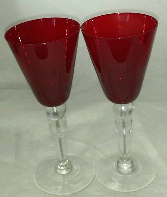 a pair of vintage ruby red wine glasses