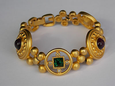 1980s Givenchy signed gold tone etruscan style bracelet with poured glass