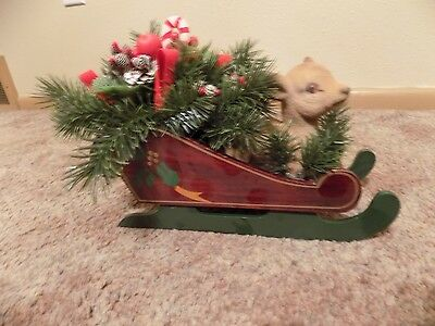 wooden sleigh with flocked deer and pine needles berries pine cones candy cane r