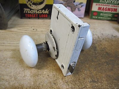 antique white porcelain door knobs and lock plate early 1900's architectural