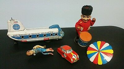 Random lot of broken tin toys for parts only