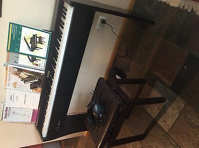 Electric piano and chair