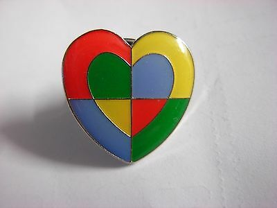 Multi coloured heart  possible Charity pin badge. Nice design