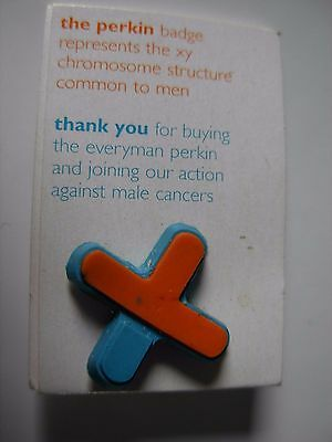 Everyman Charity pin badge. cross design. Rubber badge on card