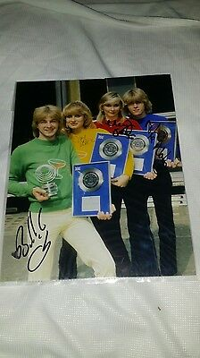 Signed 8 x 10 colour Photo by the 4 original members of Bucks Fizz.