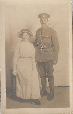 RPC Postcard: WW1 - Studio Portrait of a British Soldier and Wife (Regt. TBD)