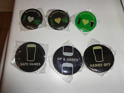 6 different guinness badges