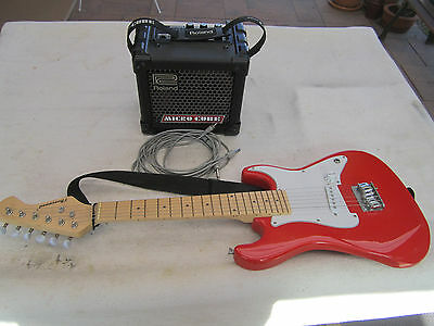 Burswood guitar and Roland micro cube guitar amplifier