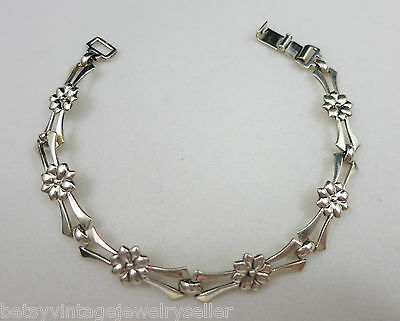 Vintage Sterling Silver Articulated Bracelet with Flowers on Panels