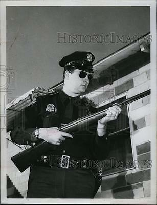 1956 Press Photo A police officer and his rifle - RSL91357