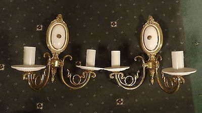 Pair of double brass wall lights