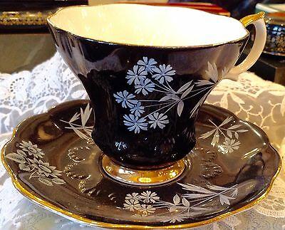 ROYAL ALBERT BLACK with WHITE FLOWERS CUP & SAUCER.