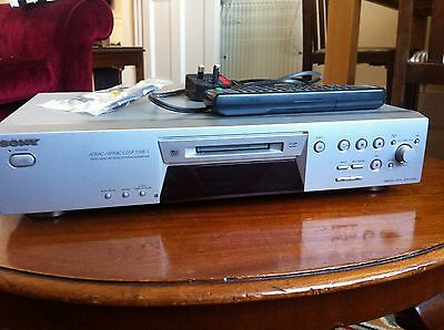 Sony MDS-JE480 Mini Disc Player with remote control and optical cable.